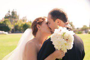 Kim_Matt_Bride_Groom_SantaBarbara_Kissing_White_Flowers