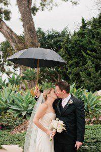 bride groom biltmore umbrella kissing