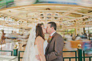 bride groom santa barbara carousel kissing