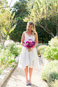 style me pretty jen rodriguez bride san ysidro ranch pink flowers purple short dress silver